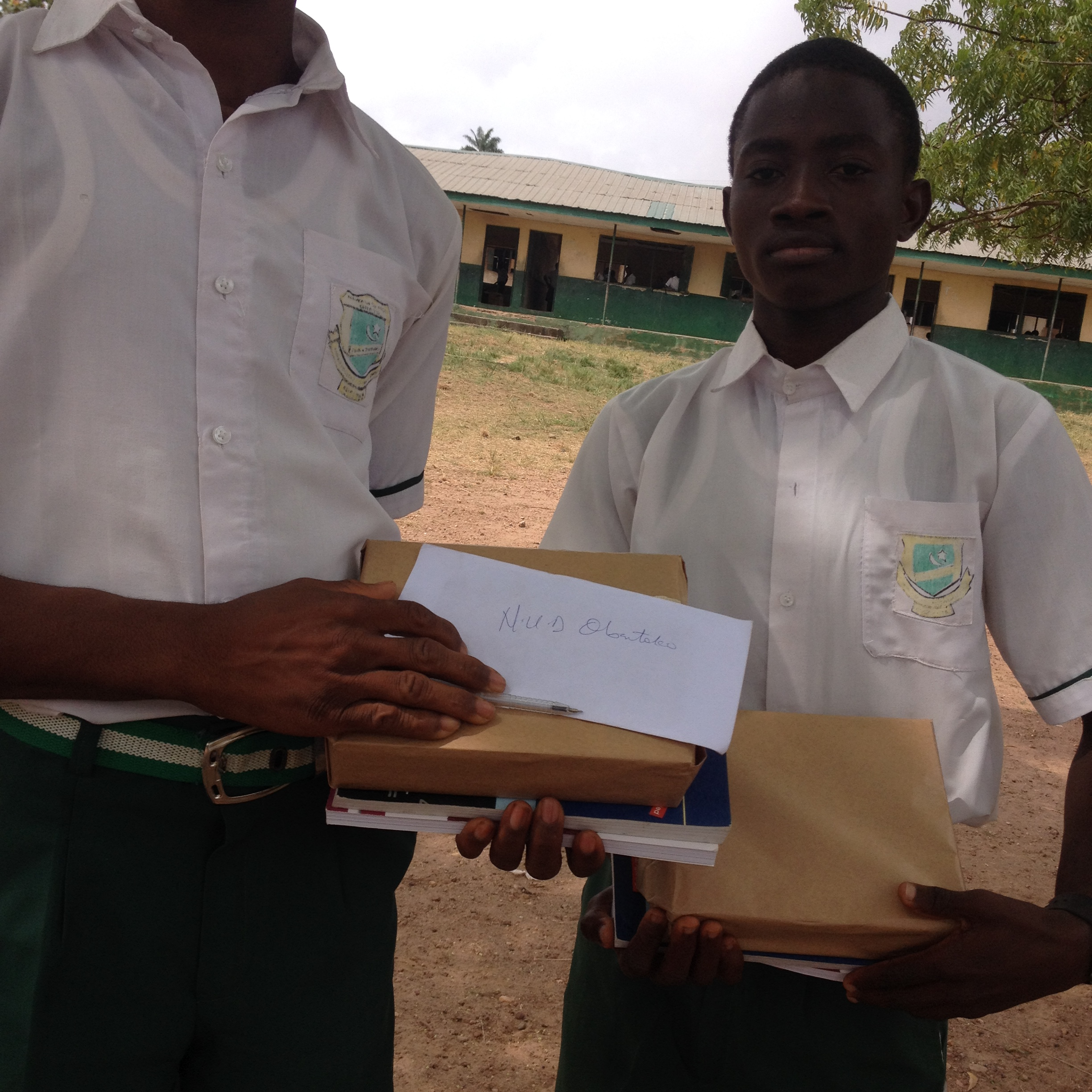 two students holding books
